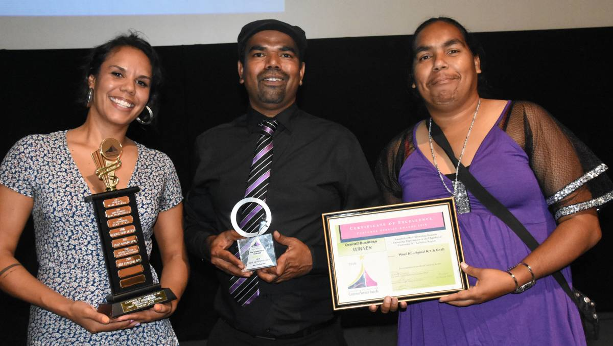 Cassandra Trevilyan-Hayes, Michael Miller and Risha McDonald from Mimi Aboriginal Arts accept the top prize on Saturday night.