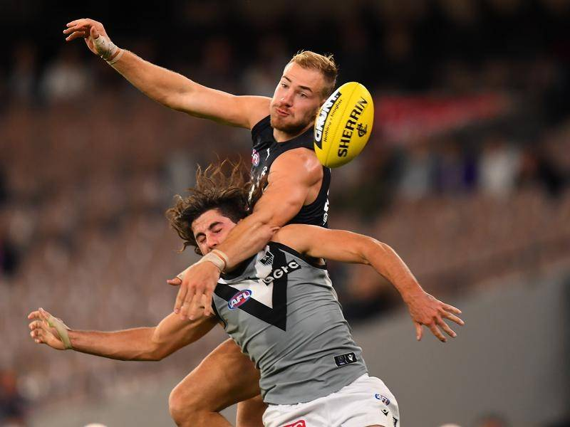 Harry McKay (top) and Lachlan Jones contest the ball during Port Adelaide's win over Carlton.