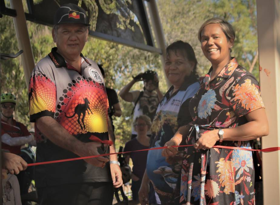 Jawoyn Association deputy chair Robert Friel, Nitmiluk Tours CEO Jane Runyu-Fordimail and Arnhem MLA Selena Uibo cut the ribbon to launch the new trails.